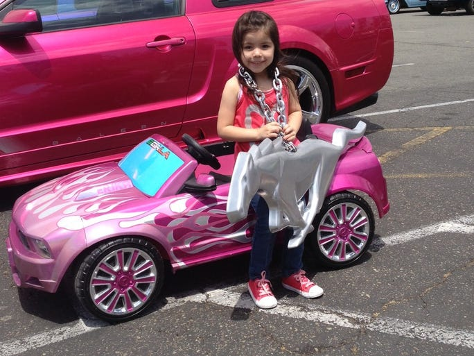 Erika Sigala shows off her first Mustang