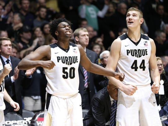 Caleb Swanigan and Isaac Haas react on the Purdue bench during Purdue's OT win over Michigan State.