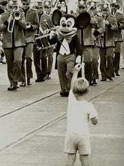 A boy stands at attention at the first Main Street Parade at Disney World's Magic Kingdom on Oct. 1, 1971.