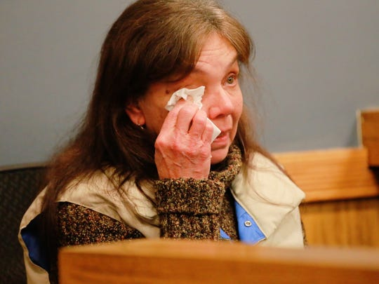 Cyndee Johnson, 57,  wipes away tears Friday as she testifies about finding a dead baby on a conveyor belt  at ReCommunity Recycling in Roseville last month.