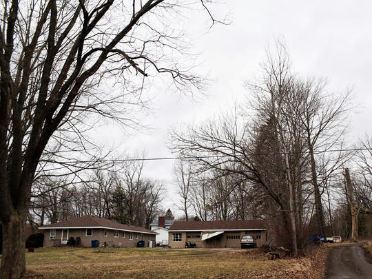 The exterior of Jason Dalton's home is seen on the corner of West East Avenue and Douglas Avenue in Cooper Twp. on Sunday, Feb. 21, 2016.