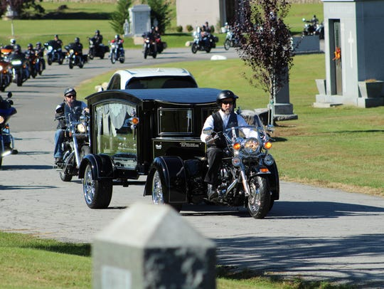 A motorcycle hearse takes the remains of Jeffrey Amato