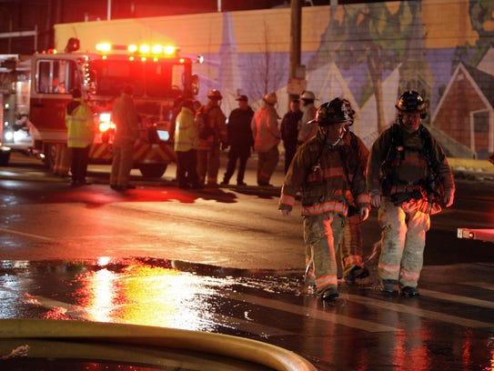 In this 2012 photo, Cincinnati firefighters work the