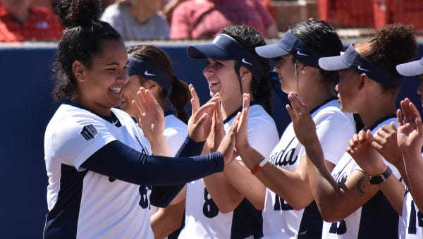 Mele Tausing, left, hit the game-winning home run for Nevada in its opener of the National Invitational Softball Championships.
