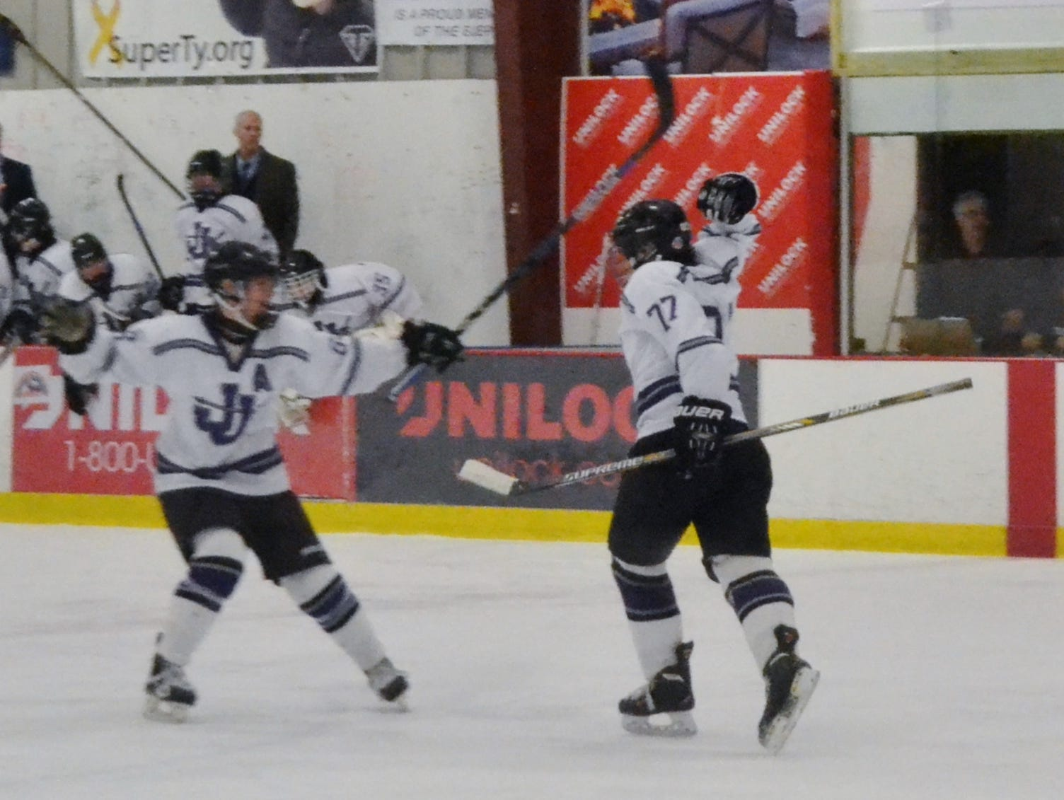 John Jay's Michael Fischetti (77) celebrates a first-period goal against Rye Town/Harrison on Wednesday in a Section 1 playoff game at Brewster Ice Arena.