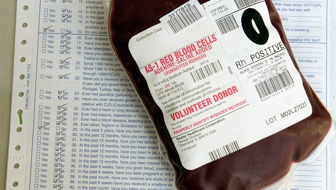 A bag of donor blood and the questionnaire donors must complete.