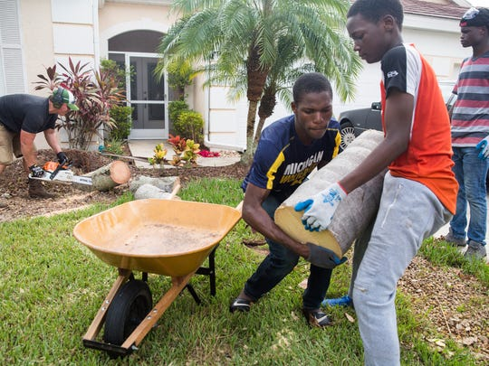 Pastor Eric Hausler assembled a team of friends, both local and from Michigan, to volunteer and help with clearing fallen trees from residents home in Naples on Thursday, September 21, 2017.