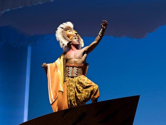 "Gerald Caesar as Simba in the U.S. tour of ""Disney's"