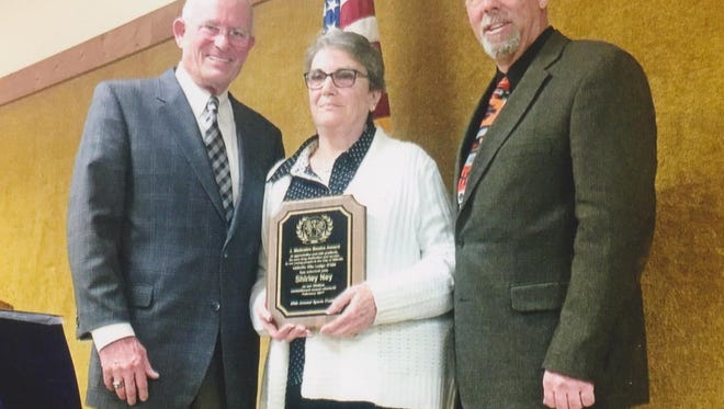 Shirley Ney (center), received Millville Elks Lodge No. 580's J. Malcolm Beebe Service To Youth Award, from Rob Shannon (left), chairman of the Millville Elks Sports Frolic, and Keith Rafine, Exalted Ruler, Millville Elks Lodge No. 580, during the lodge's 69th annual Sports Frolic.
