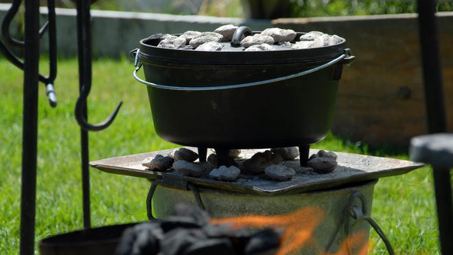 In Dutch oven cooking, coals are placed concentrically beneath and atop the oven. Even spacing of coals promotes even cooking.