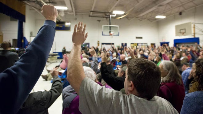 Residents vote during Westford town meeting in March.