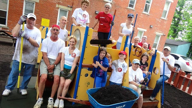 GO Cincinnati volunteers working at a school last year. They will be at 10 schools on the East Side Saturday.
