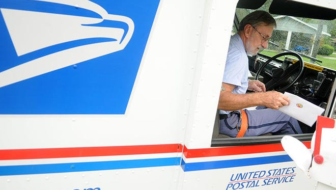 This 2009 file photo shows Paul McNeil delivering the mail in Hattiesburg, Miss.