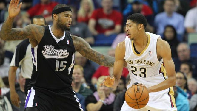 New Orleans Pelicans forward Anthony Davis (23) is defended by Sacramento Kings center DeMarcus Cousins (15) in the first quarter at the Smoothie King Center.