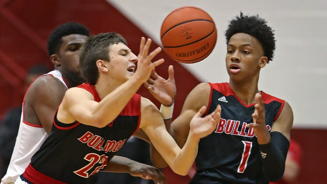 New Albany's #22 Isaac Hibbard battles for the ball with teammate #1 Romeo Langford during the North Central vs New Albany basketball game of the Tip Off Classic at Southport Fieldhouse, Saturday, December 10, 2016.  North Central won the game 84-60.