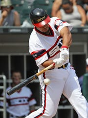 Jose Abreu hits a single in the 6th inning against the Atlanta Braves  on July 10.