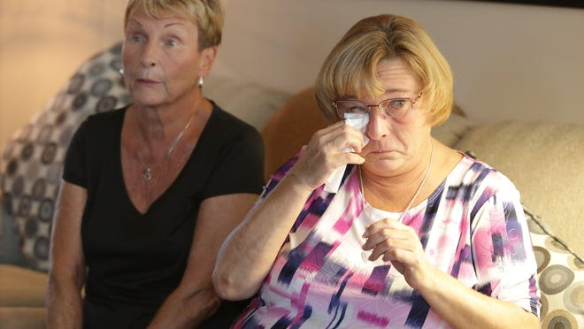 Dawn Millar, mother of Brandon Bushe, wipes away tears as she and her mother Diana Mihal talk about him being shot to death July 21 in Canton.