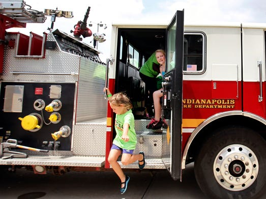 Campers climb through a fire truck at the Firefighter for a Day Camp at the Warren Township Government Center on Tuesday, June 17, 2014.