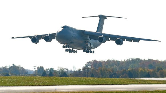 A C-5M Super Galaxy touches down at Dover Air Force Base, Del., on Nov. 6, 2010.