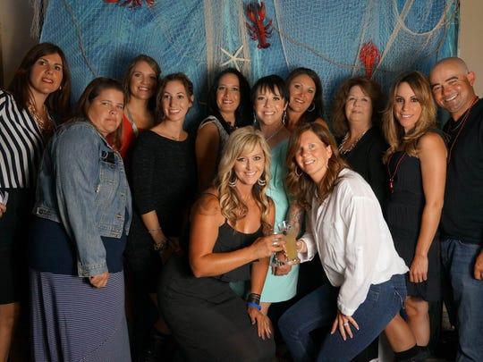 From left, Rosanna Catalano, Jennifer Rincon, Rochelle Duckworth, Jennifer Mathieu Rust, Mali Cuda, Jackie Meroney, Callie Laporte, Barbara carpenter, Renee Martine, Johnny Martine and in front Stephanie Morgan and Kelly Lepai.