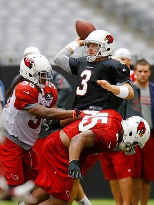 Cardinals quarterback Carson Palmer throws during training camp last summer.