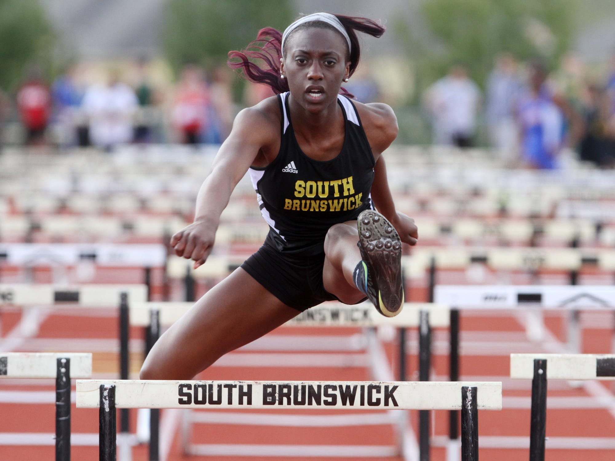 Aspen McMillan runs the shuttle hurdle anchor leg for South Brunswick at the GMC Relays, Tuesday, April 28, 2015, in South Brunswick, NJ.