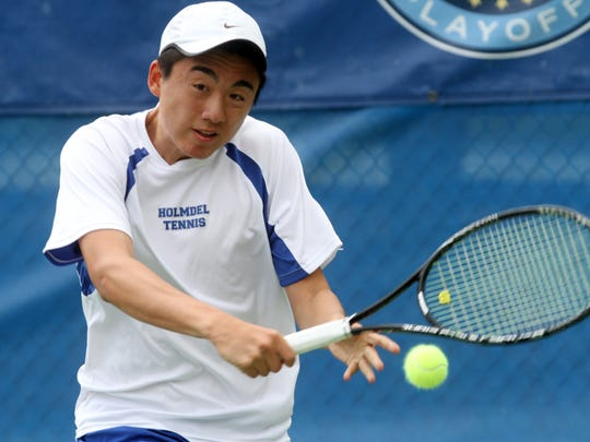 Holmdel's Michael Chen backhands a shot during his semifinal first singles match against Northern Valley Regional's Michael Rozenvasser at the NJSIAA Team Tennis Championships, Wednesday, May 20, 2015, at Mercer County Park in West Windsor Township, NJ.