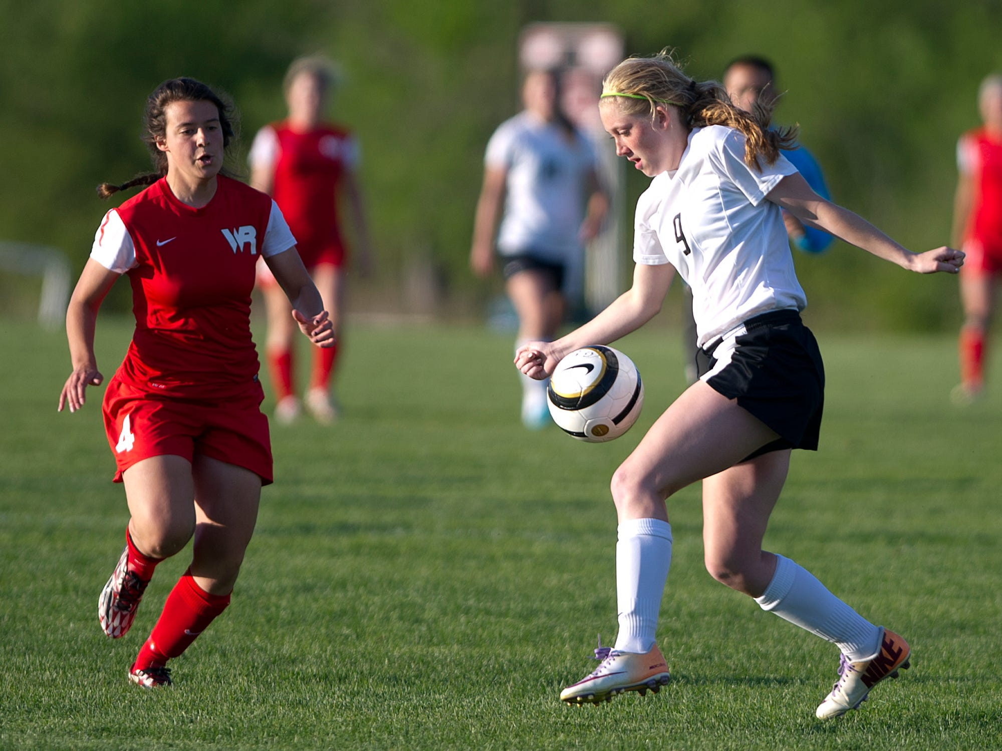 Wisconsin Rapids' Katie Kiiskila, left, against Stevens Point Area Senior High's Courtney Milkowski during Thursday's Wisconsin Valley Conference soccer game at the Portage County Youth Soccer Complex in Stevens Point.