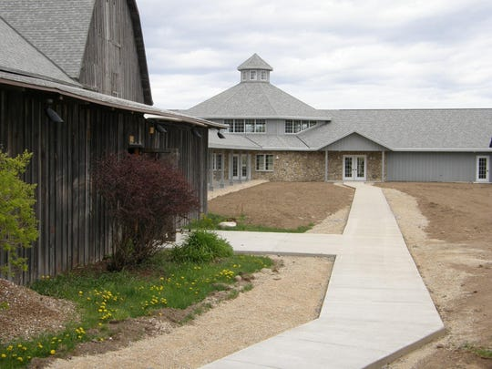 Juniper Hall, background, was built in 2008 at Birch Creek to provide dedicated rehearsal space and an additional small concert venue.