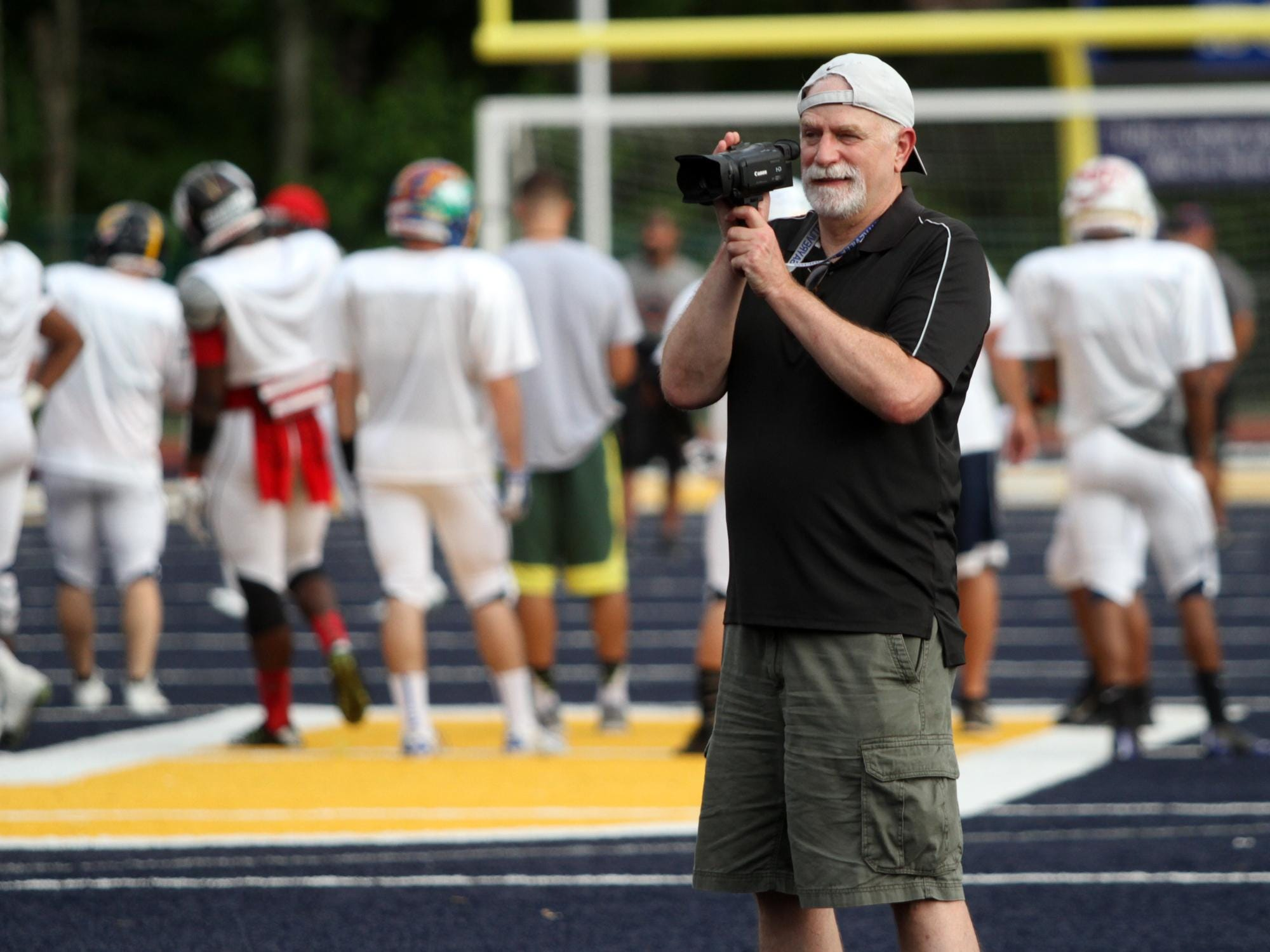 Videographer Joe DaRold tapes football players while they practice for Snapple Bowl XXII, Wednesday, July 8, 2015, at Colonia High School in Woodbridge, NJ.