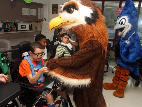 Snapple Bowl mascots greet students during a visit to the Lakeview School on Monday in Edison.