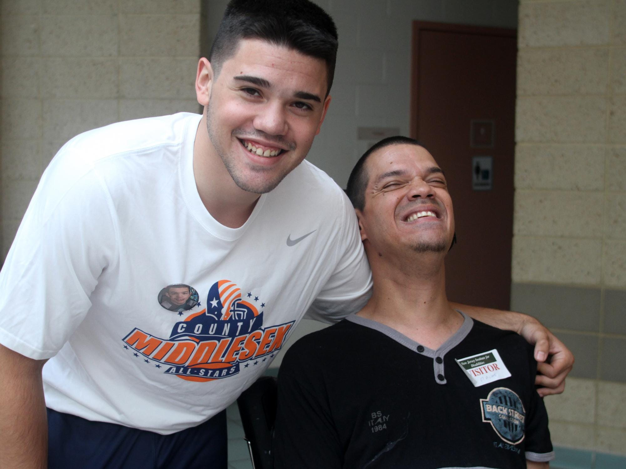 Snapple Bowl football player Noah Torino poses with his uncle Machi Torino, a former Lakeview School student, during visit to the school in Edison on Monday.