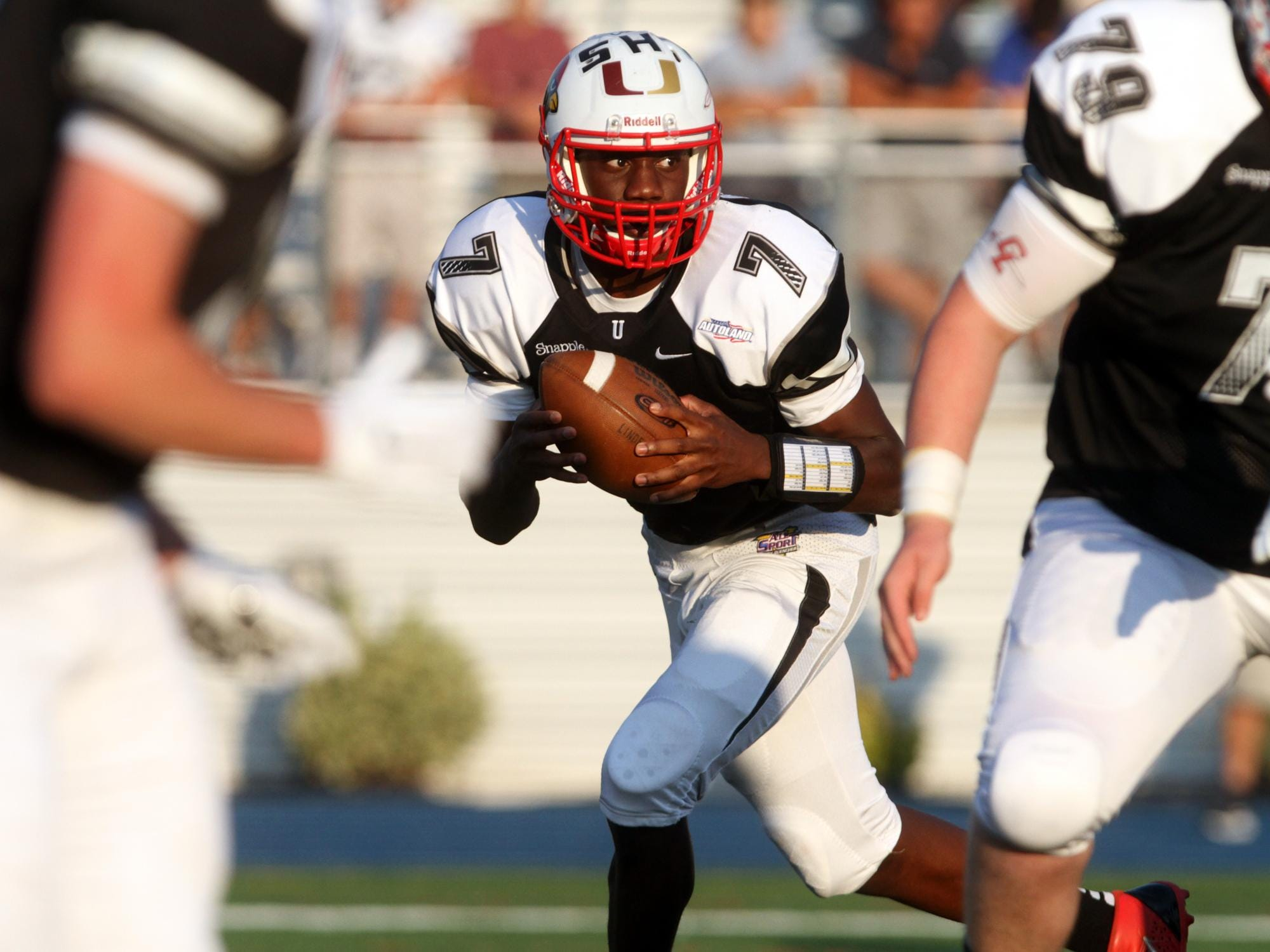 Union County quarterback Rohan Phillip of Plainfield drops back to pass during Snapple Bowl XXII on Thursday at Kean University in Union.
