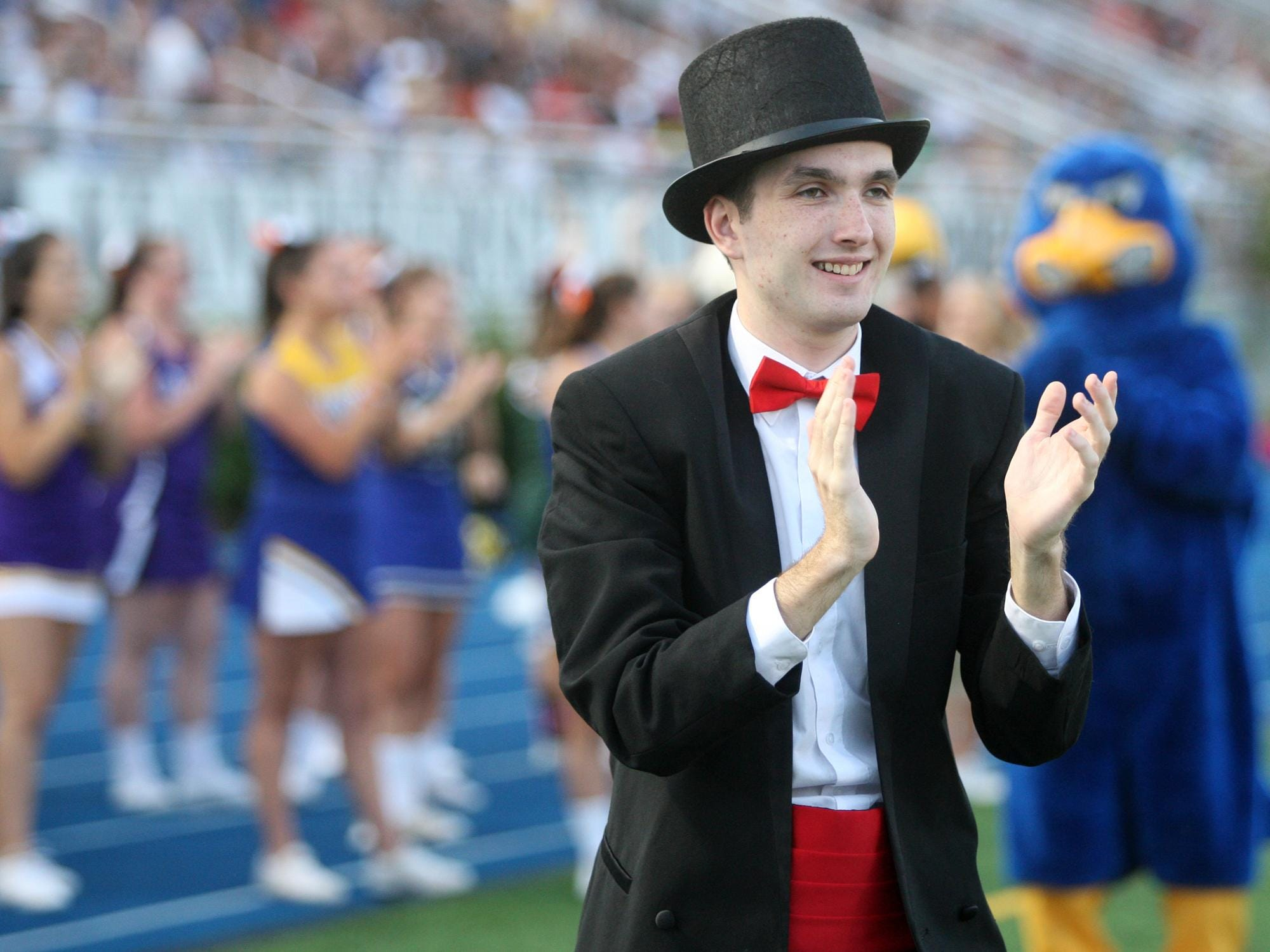 Woodbridge Barrons mascot Johnathon O'Halloran celebrates a Middlesex touchdown Thursday during Snapple Bowl XXII at Kean University in Union.