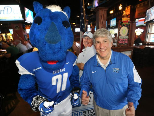 The MTSU mascot Lightning stands with Chris Massaro, director of athletics at MTSU, at the Lunch with Lightning event Thursday.