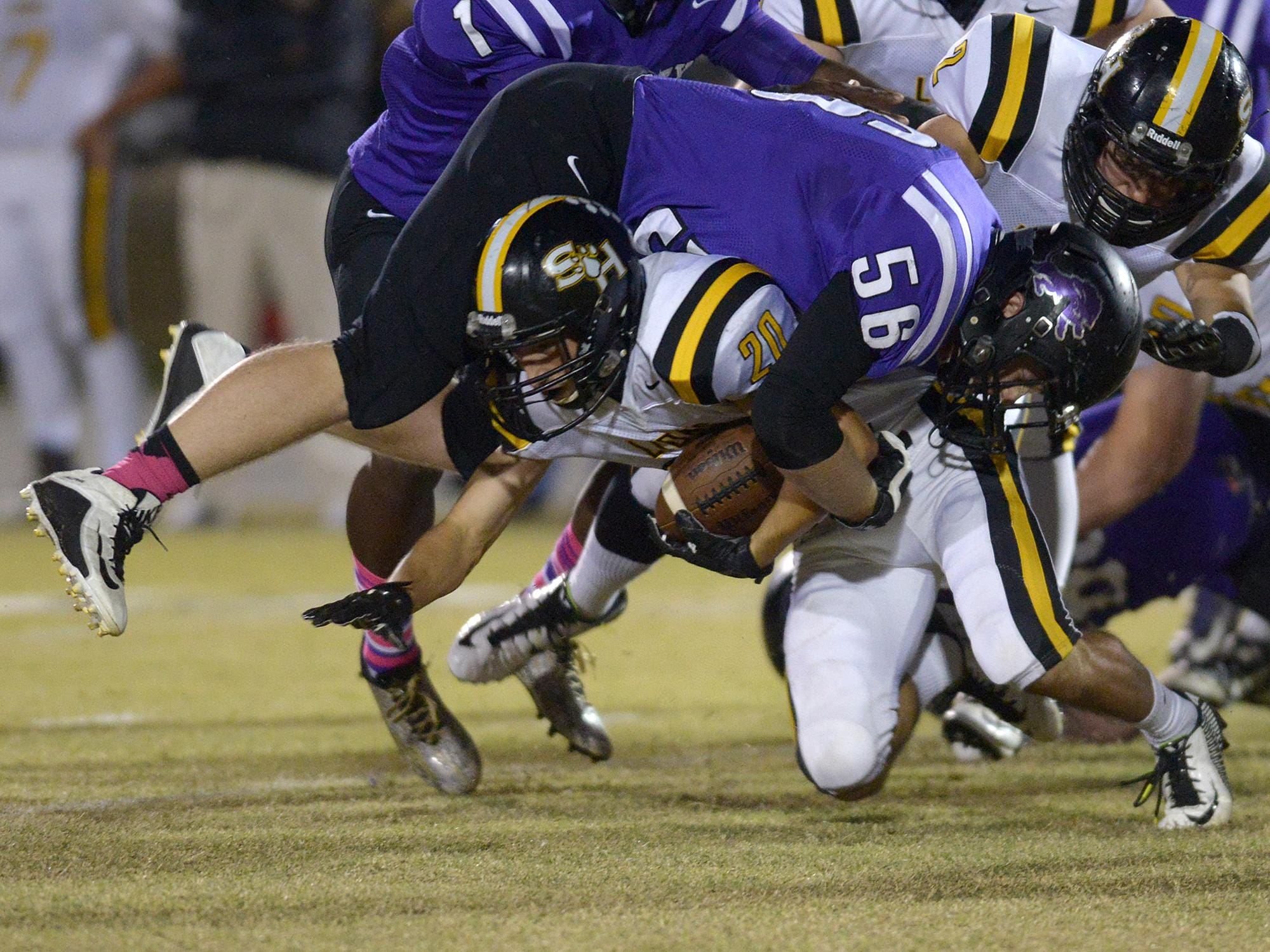 Trinity Christian Academy's Zachary Yarbrough (56) brings down Scotts Hill's Cody Holmes (20) at TCA on Friday.