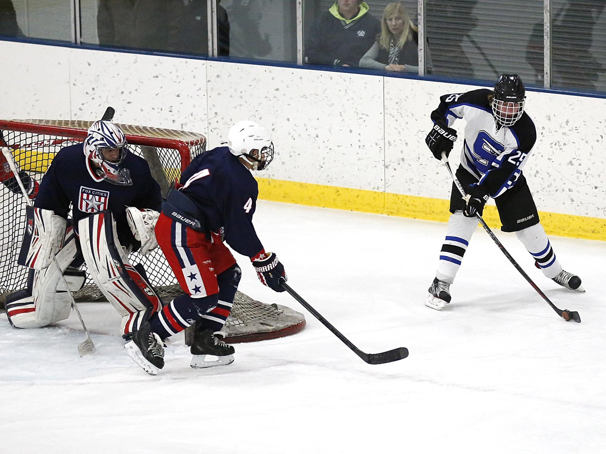 St. Mary's Springs' Mitchell Grebe works his way around the Fox Cities Stars' net Tuesday night at the Blue Line Family Ice Center in Fond du Lac.