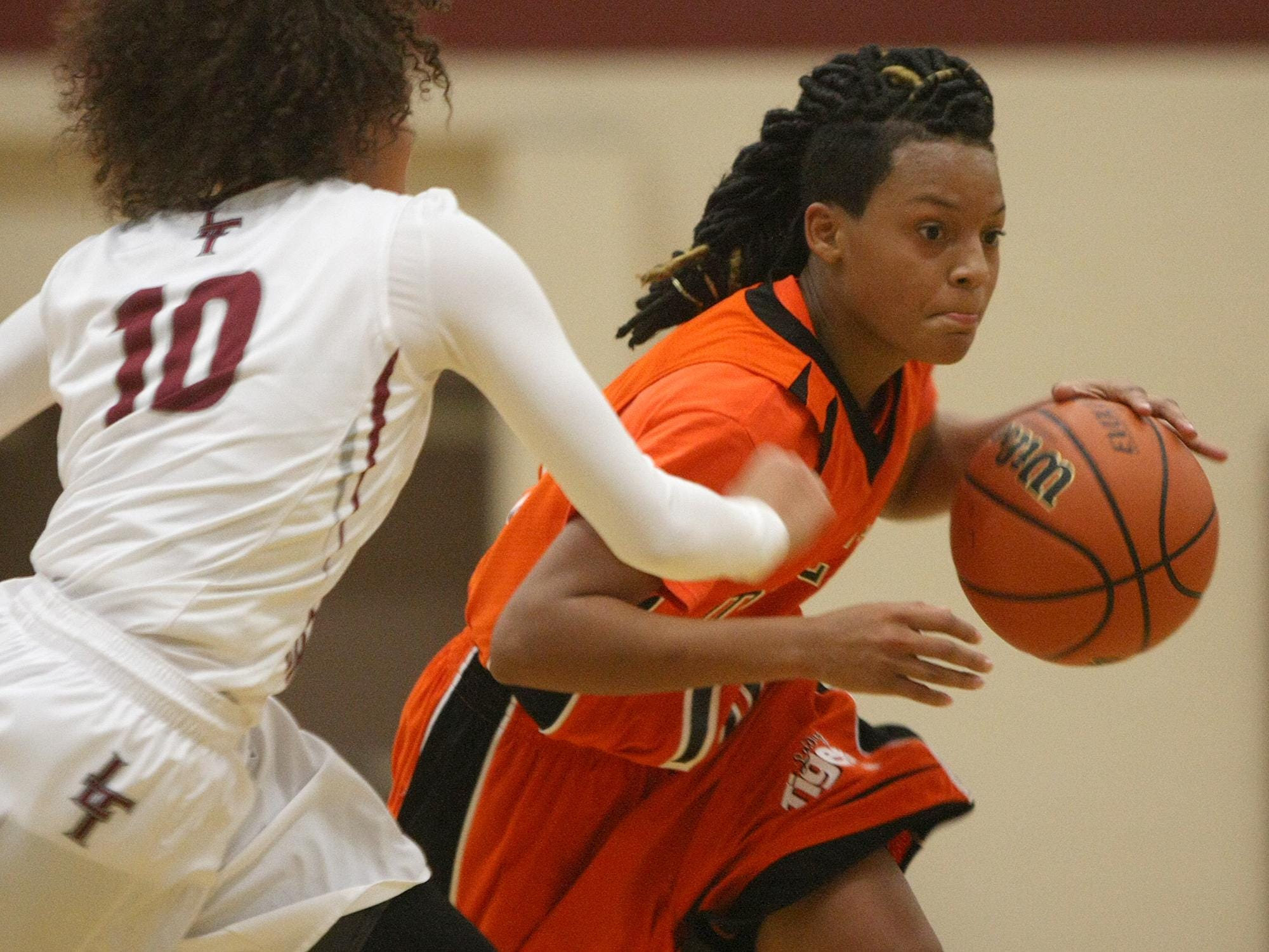Middleton's Sequoya Warren (10) dribbles, while Liberty's Aleysia Mason-Pavia (10) defends, at Liberty Tech High School, on Tuesday, Dec. 1, 2015.