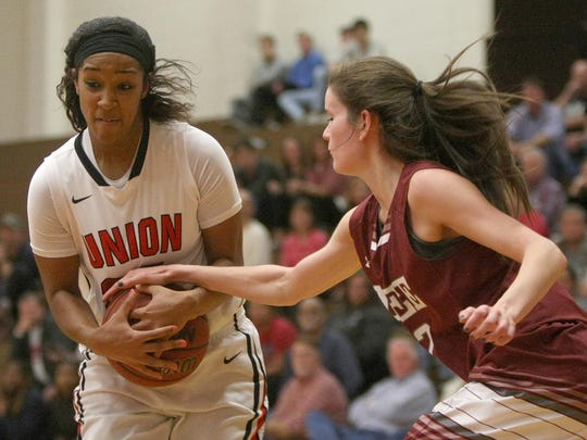 Union University guard Bethany Lytle (24) drives against Lee University guard Erin Walsh (12) on Saturday at Union.