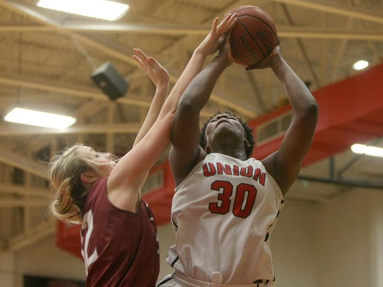 Union University forward Tiara Caldwell (30) had 21 points and 11 rebounds Saturday against Lee.