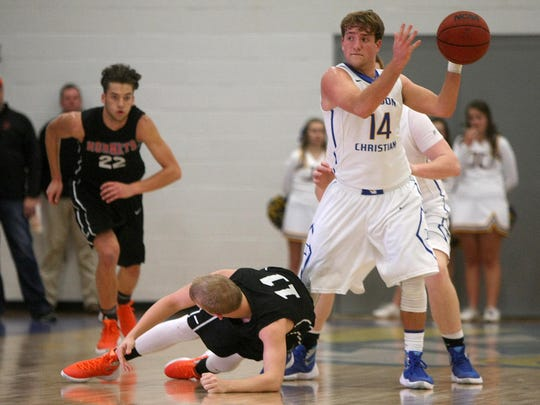 Jackson Christian's Clay Lewis grabs a loose ball against South Gibson.