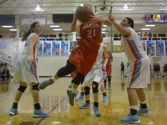 Bradford's Morgan Martin (21) is fouled by Gibson County's Justyce White (23) as she flies to the rim at Gibson County High School's Bo Booth Gymnasium, in Dyer, Tenn., on Friday, Jan. 8, 2016.