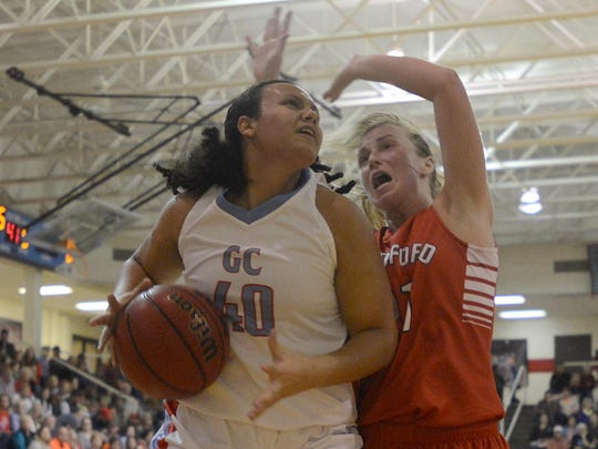 Gibson County's Serena Roach (40) collides with Bradford's Morgan Martin (21) on her way to the rim on Friday.