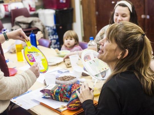 Abigail Lichliter shows Tammy Brown an interactive