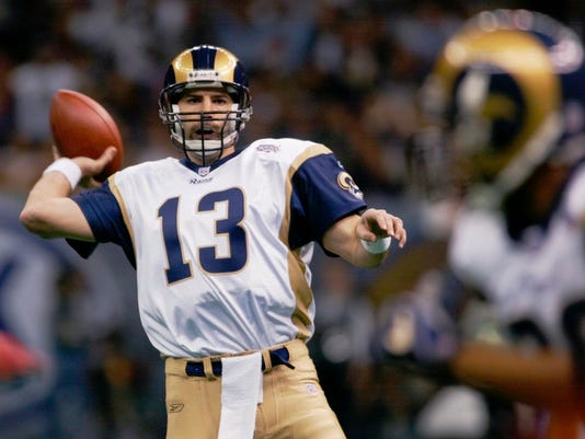 FILE - In this Feb. 3, 2002, file photo, St. Louis Rams quarterback Kurt Warner looks to pass to Marshall Faulk,  right, during the first quarter against the New England Patriots in NFL football's Super Bowl XXXVI in New Orleans. The Patriots defeated the Rams 20-17. (AP Photo/Doug Mills, File)