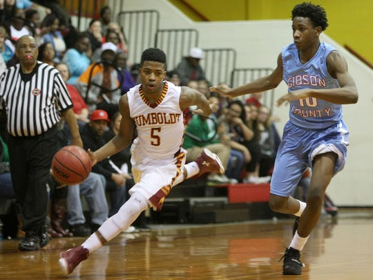 Humboldt's Jarred Walker (5) drives past Gibson County's Jamerious Skinner (10) at Humboldt High School on Friday, Feb. 5, 2016.