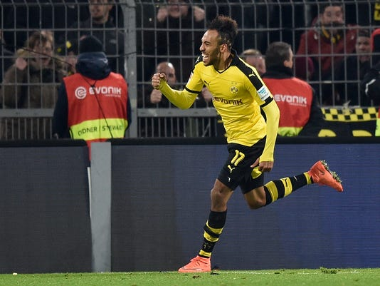 Dortmund's Pierre-Emerick Aubameyang  celebrates his final goal during the German Bundesliga soccer match between Borussia Dortmund and TSG 1899 Hoffenheim in Dortmund, Germany, Sunday, Feb. 28, 2016. Dortmund defeated Hoffenheim with 3-1. (AP Photo/Martin Meissner)