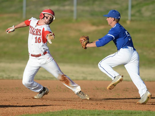 Lexington's Tyler Anderson (16) tries to avoid the tag from Chester County's Drew Hill (5) at Guy B. Amis Park on Monday.
