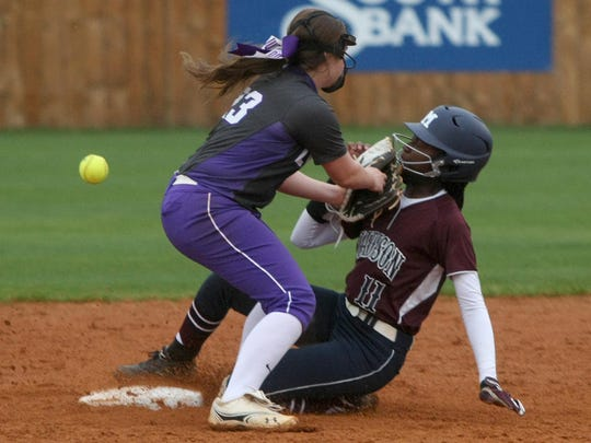 Madison's Lauren Parks slides into second base as the ball goes by TCA's Hannah Thomas on Thursday.