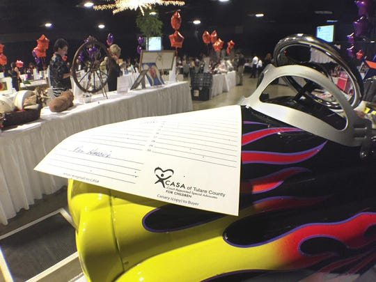 A child's pedal car was among the many silent auction items available during CASA's 22nd annual dinner auction at the Visalia Convention Center on Friday, May 6, 2016.